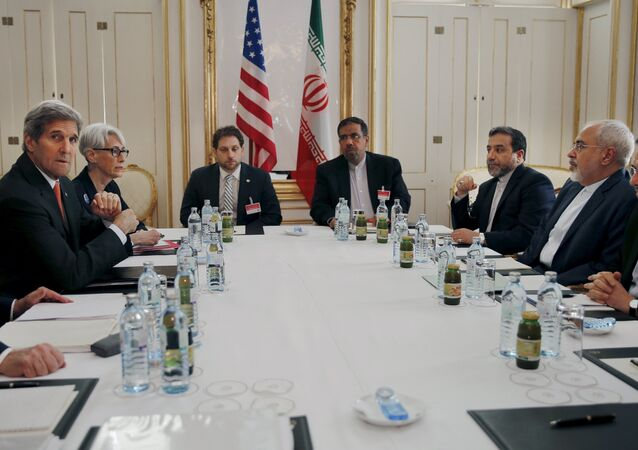 U.S. Secretary of Energy Ernest Moniz, U.S. Secretary of State John Kerry and U.S. Under Secretary for Political Affairs Wendy Sherman (L-3rd L) meet with Iranian Foreign Minister Mohammad Javad Zarif (2nd R) at a hotel in Vienna, Austria