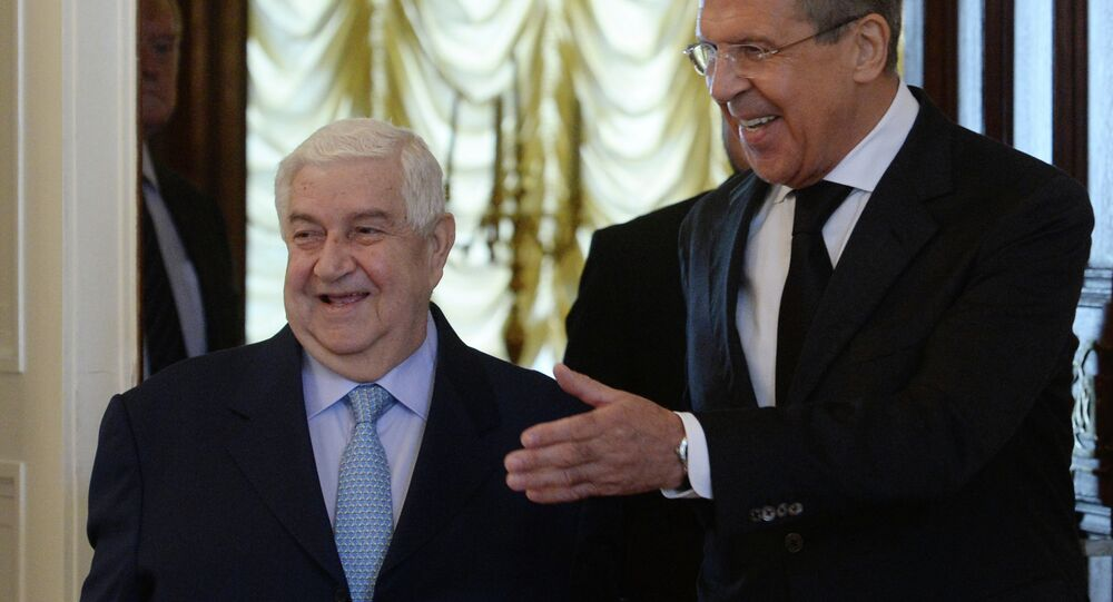 Russian Foreign Minister Sergei Lavrov, right, and his Syrian counterpart Walid Muallem during a meeting in Moscow