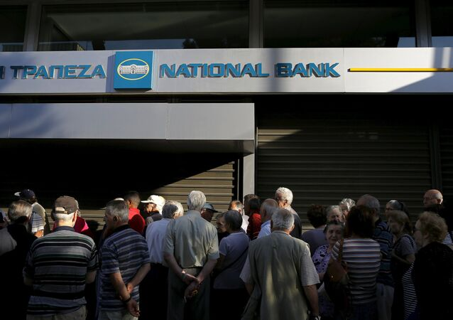 Dozens of pensioners line up outside a branch of the National Bank of Greece hoping to get their pensions, in Athens, Greece June 29, 2015