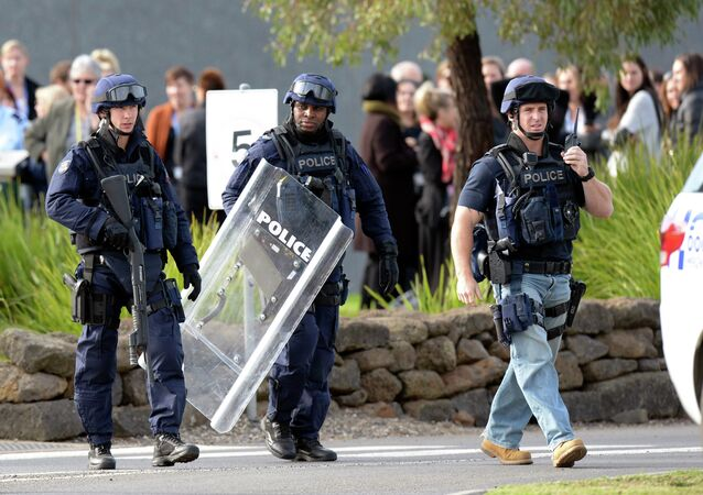 In this Tuesday, June 30, 2015 photo, police walk outside Ravenhall Prison in Melbourne, Australia