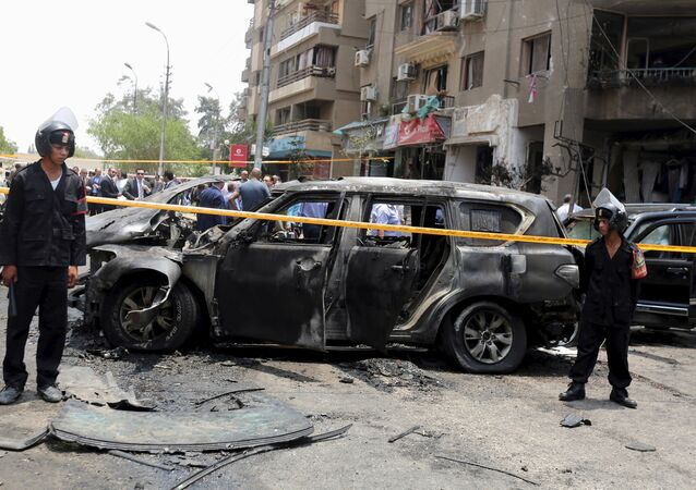Policemen secure the site of a car bomb attack on the convoy of Egyptian public prosecutor Hisham Barakat near his house at Heliopolis district in Cairo, Egypt, June 29, 2015