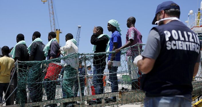 Migrants disembark from the Panamanian ship Dignity 1 in the Sicilian harbour of Pozzallo, Italy, June 23, 2015
