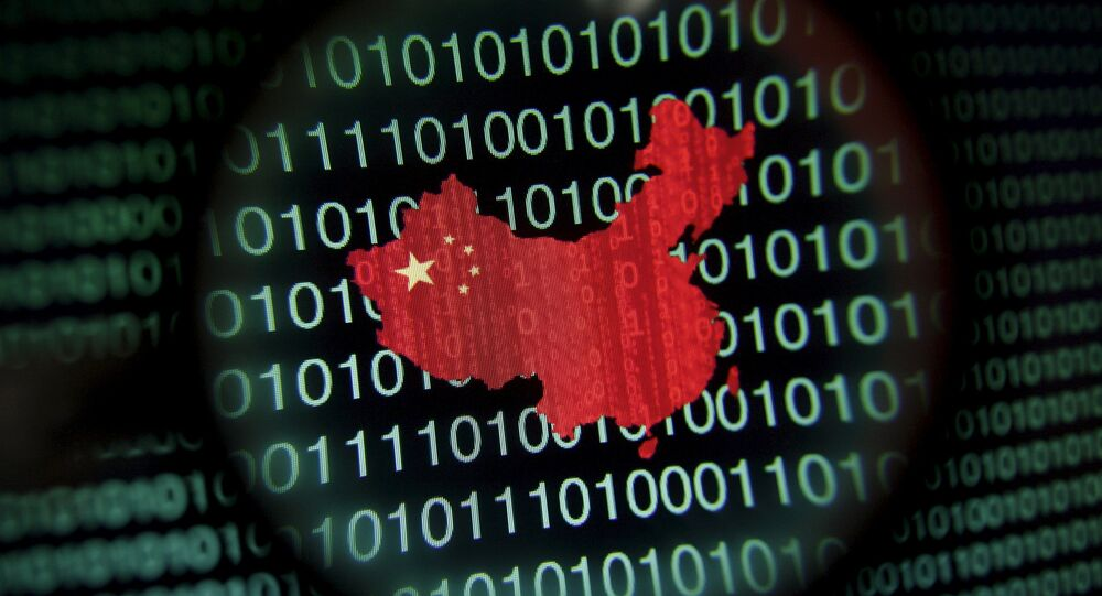 A map of China is seen through a magnifying glass on a computer screen showing binary digits in Singapore in this January 2, 2014 file photo illustration