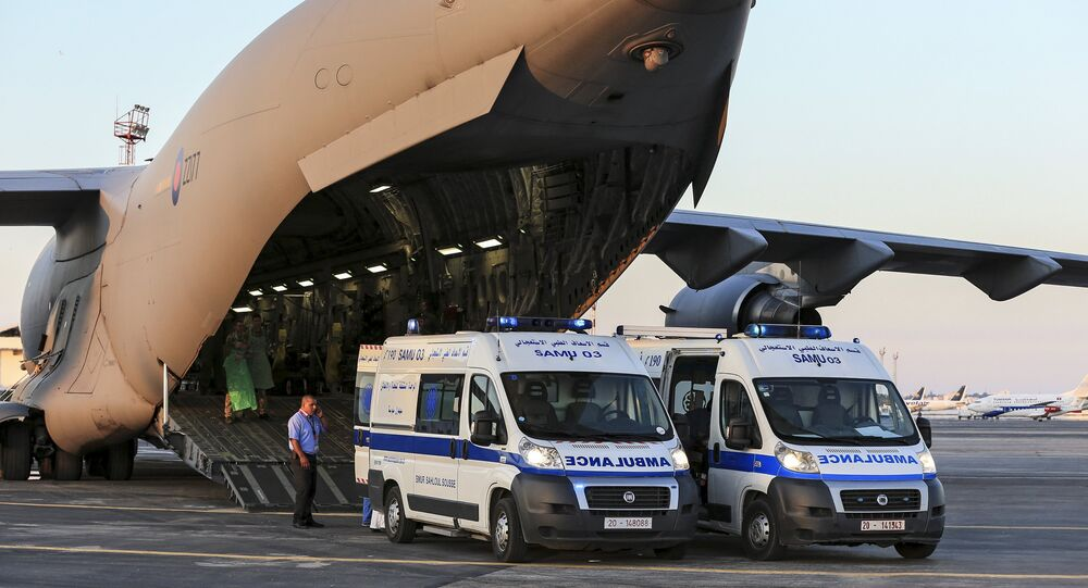 Tunisian ambulances bring seriously injured British nationals to a Royal Air Force C17 aircraft at Monastir airport in Tunisia, in this June 29, 2015 handout photograph released by Britain's Ministry of Defence in London on June 30, 2015