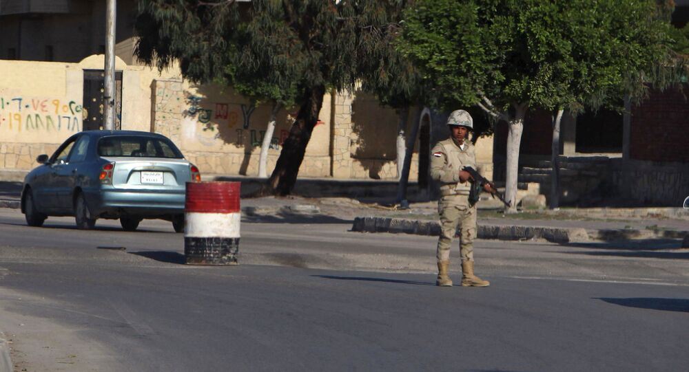 An Egyptian soldier mans a checkpoint in el-Arish, 290 kilometers (180 miles) east of Cairo, North Sinai, Egypt, Saturday, Jan. 31, 2015