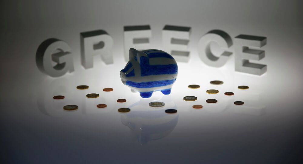 A piggybank painted in the colours of the Greek flag stands amongst various euro coins in front of letters spelling the word 'GREECE' in this picture illustration taken in Berlin, Germany June 30, 2015