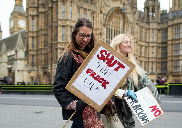 Activists attend an anti-fracking rally outside the Houses of Parliament in central London