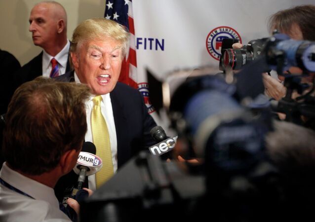 Donald Trump speaks to reporters after addressing at the Republican Leadership Summit Saturday, April 18, 2015, in Nashua, N.H.