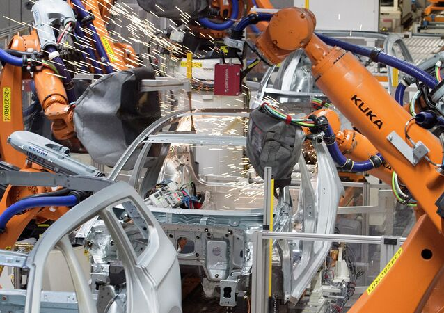 Robots weld a car body at the plant of the German car manufacturer Volkswagen Sachsen in Germany, Monday, Jan. 26, 2015