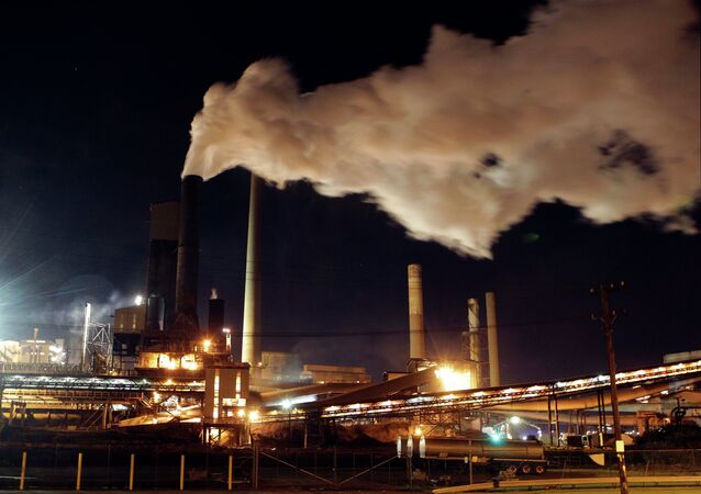 In this photo taken Friday, July 8, 2011, smoke bellows from a chimney stack at BlueScope Steel's steelworks at Port Kembla, south of Sydney, Australia