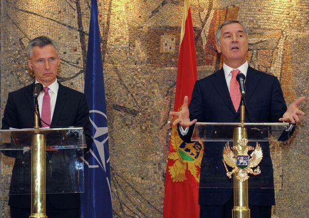 Montenegro's Prime Minister Milo Djukanovic, right, speaks and gestures after talks with NATO Secretary-General Jens Stoltenberg, in Podgorica, Montenegro, Thursday, June 11, 2015