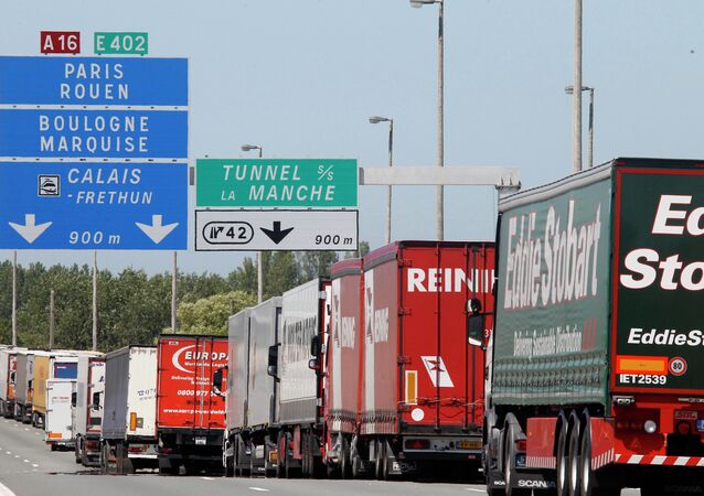 Trucks are stuck in a traffic jam on a highway leading to the Channel tunnel after striking workers invaded the Eurotunnel train tracks in Calais, northern France, in a protest against job cuts, 30 June 2015.