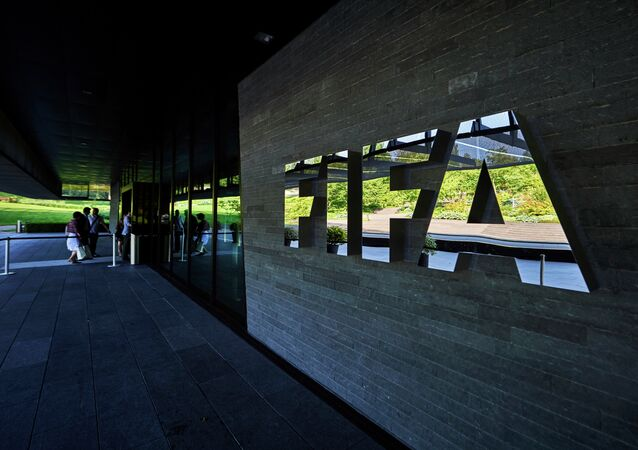 This file photo taken on June 3, 2015 shows FIFA employees entering the FIFA headquarters in Zurich