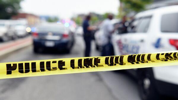 Police officers work behind police tape blocking a street near the Washington Navy Yard in Washington, Thursday, July 2, 2015 - Sputnik International