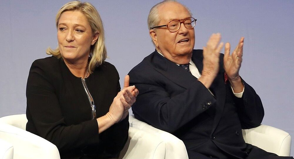 French far-right Front National leader Marine Le Pen and her father Jean-Marie Le Pen in Lyon, central France.