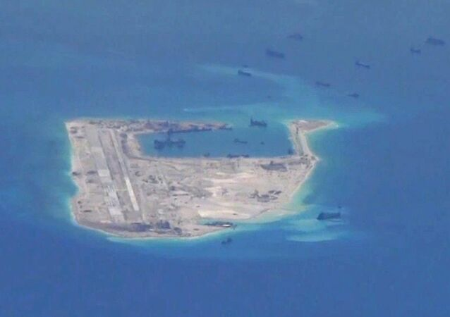 Chinese dredging vessels are purportedly seen in the waters around Fiery Cross Reef.