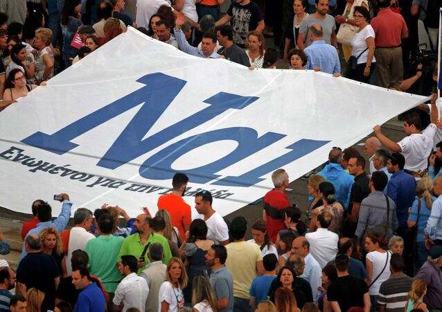 The word 'Yes' in Greek is seen on a banner during a pro-Euro rally in front of the parliament building, in Athens, Greece, June 30, 2015