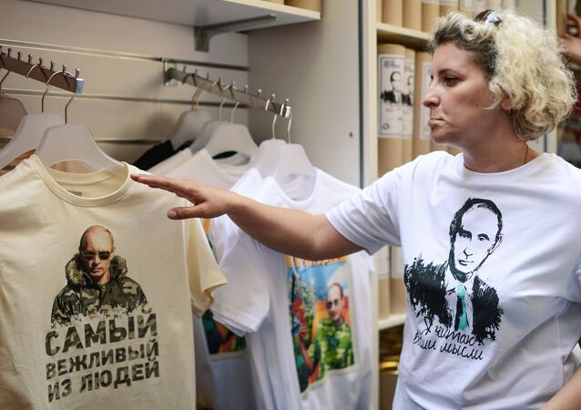 A buyer at the GUM during the beginning of rally for selling T-shirts depicting Russian President Vladimir Putin