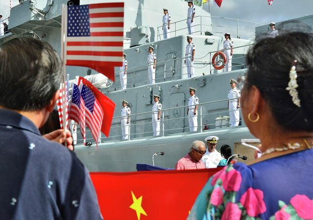 PEARL HARBOR (Sept. 6, 2013) Members of the Chinese community in Hawaii greet visiting sailors of the Chinese People's Liberation Army-Navy upon their arrival to Joint Base Pearl Harbor-Hickam