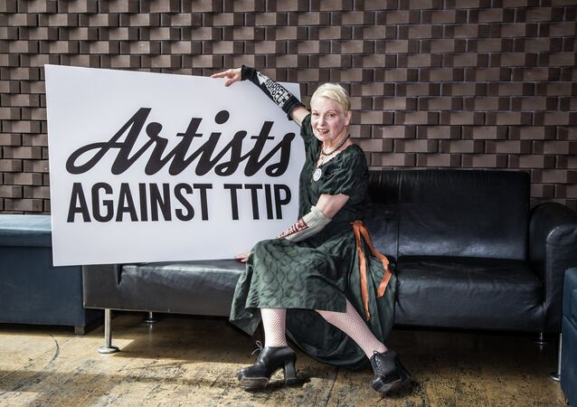 Dame Vivienne Westwood poses for photographers during a photocall for the launch of Artists Against TTIP (Transatlantic Trade and Investment Partnership) at the Young Vic Theatre in London, Thursday, July 2, 2015