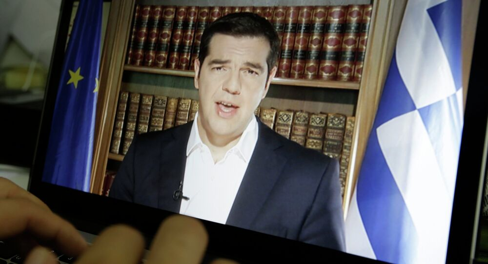 An Associated Press TV producer edits the video of Greece's Prime Minister Alexis Tsipras televised address to the nation in Athens, Friday, July 3, 2015