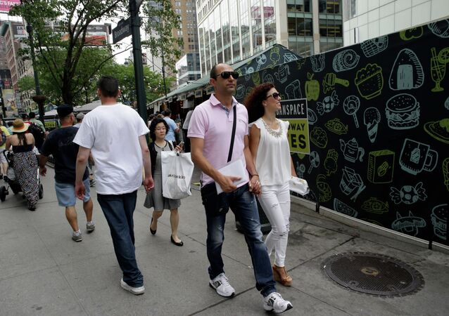 Newlyweds Valasia Limnioti, right, and Konstantinos Patronis walk in Midtown Manhattan, Thursday, July 2, 2015, in New York. The couple topped the dream trip of our lives in New York City, where their three-week honeymoon turned into a nightmare: Their Greek-issued credit cards were suddenly declined and they were left nearly penniless. Strangers from two Greek Orthodox churches in Queens came to their rescue, giving them survival cash until their flight home to Greece this Friday.