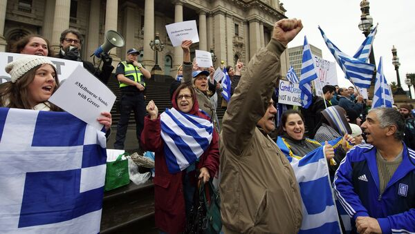 Protestors wave the Greek flag as they shout Oxi (No) during the Melbourne stands with Greece solidarity rally outside Parliament House in Melbourne on July 4, 2015 - Sputnik International
