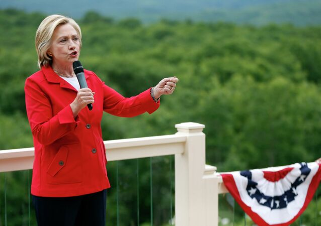 Democratic presidential candidate Hillary Rodham Clinton speaks to supporters at organizing event at a private residence, Saturday, July 4, 2015, in Glen, N.H.