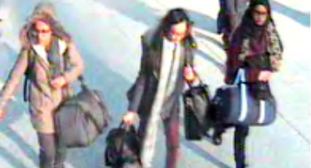 Amira Abase, left, Kadiza Sultana, center, and Shamima Begum, walk through Gatwick airport, south of London, before catching their flight to Turkey on Tuesday Feb 17, 2015