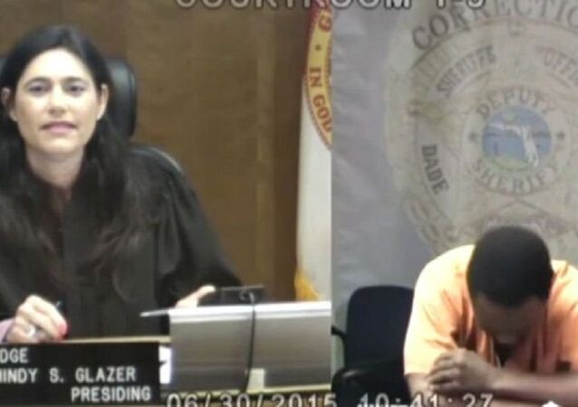 Miami-Dade County Judge Mindy Glazer, left, and Arthur Booth
