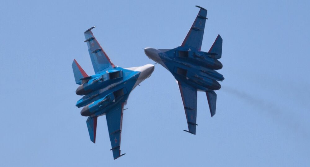 Russian Vikings aerobatics team performing on board SU-27 planes at the opening ceremony of the Fifteenth International Maritime Defense Show in St.Petersburg.