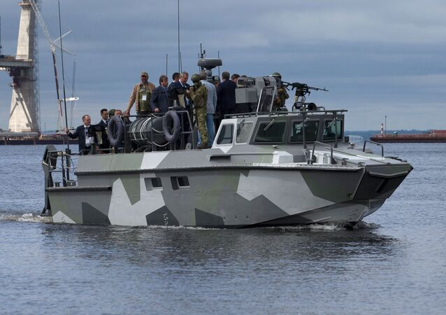 Vice-prime Minister Dmitry Rogozin (center) on board the warfare craft at the opening ceremony of the Fifteenth International Maritime Defense Show in St.Petersburg.