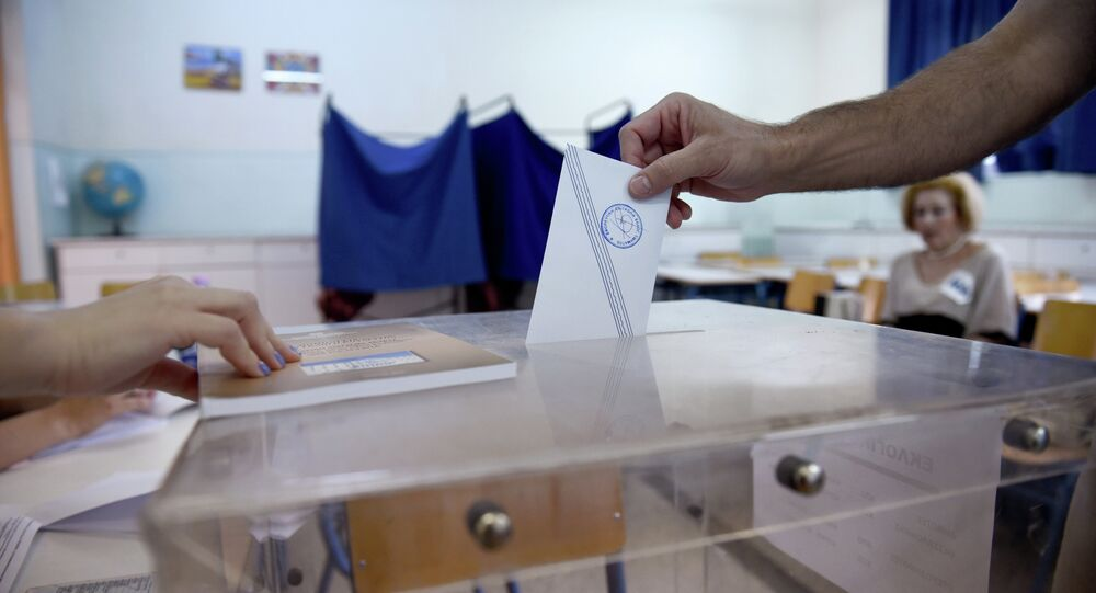 A man casts his vote at a polling station in the northern Greek port city of Thessaloniki, Sunday, July 5, 2015