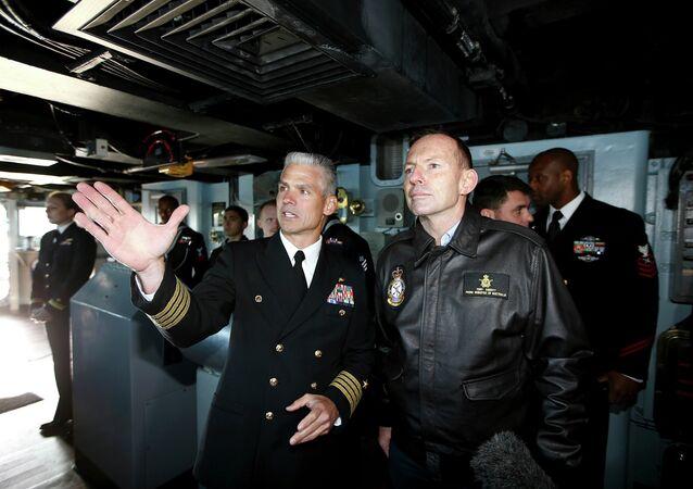 Australian Prime Minister Tony Abbott, right, speaks to Captain Kyle P. Higgins onboard the USS Blue Ridge as she arrives in Sydney Harbour, Australia, Friday, July 3, 2015