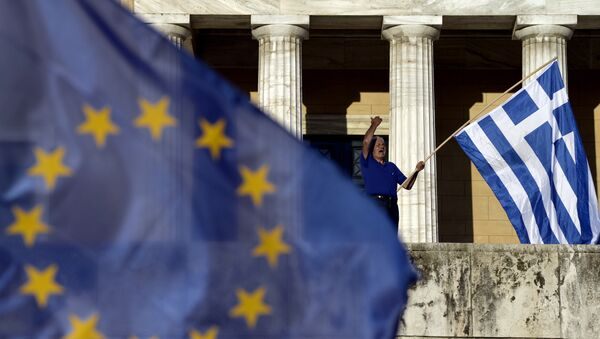A protester shouts slogans during a pro-European demonstration in front of the Greek parliament in Athens - Sputnik International