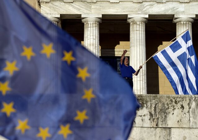 A protester shouts slogans during a pro-European demonstration in front of the Greek parliament in Athens