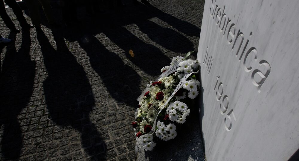 War veterans from the Balkan war of the 1990's stand near a memorial at the memorial center Potocari, near Srebrenica, 150 kms northeast of Sarajevo, Bosnia