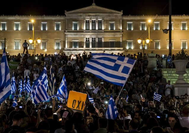 No supporters celebrate referendum results on a street in central in Athens, Greece July 5, 2015