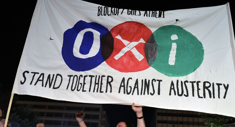 'NO' supporters hold a banner reading 'NO' in front of the parliament late in Athens on July 5, 2015