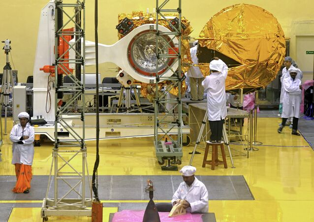 Scientists and engineers working on the Mars Orbiter vehicle at the Indian Space Research Organisation's (ISRO) satellite centre in Bangalore.