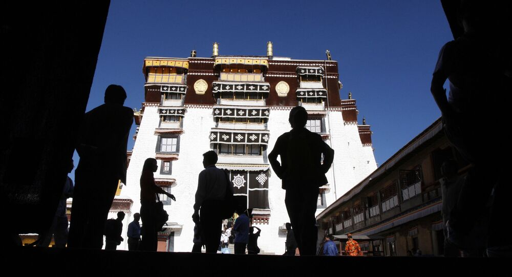 Tourists walk through the Potala Palace in Lhasa, the capital of Tibet, China, Saturday, June 20, 2009.