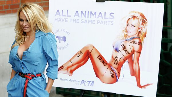 Canadian born actress Pamela Anderson poses for photographers during a photocall to unveil a new advertisement in aid of People for the Ethical Treatment of Animals (PETA) in London. - Sputnik International