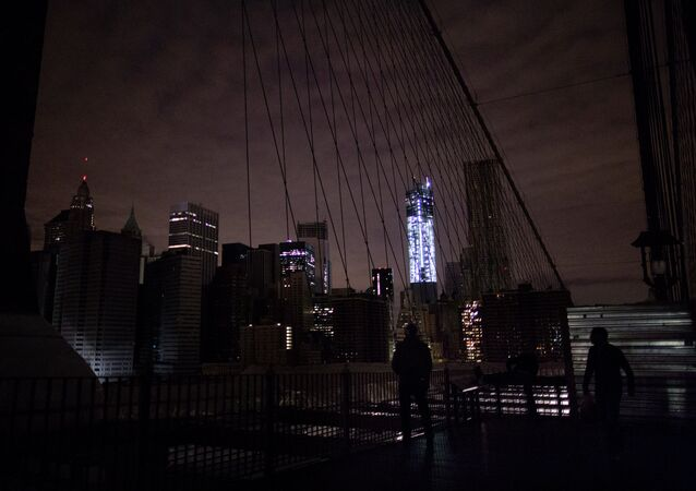 Lower Manhattan, as viewed from the darkened Manhattan side of the pedestrian walkway of the Brooklyn Bridge in New York, during the 2012 blackout.