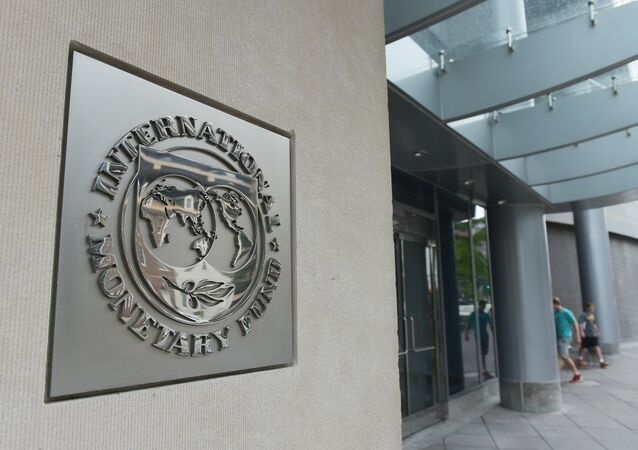 The seal of the International Monetary Fund is seen on a headquarters building in Washington