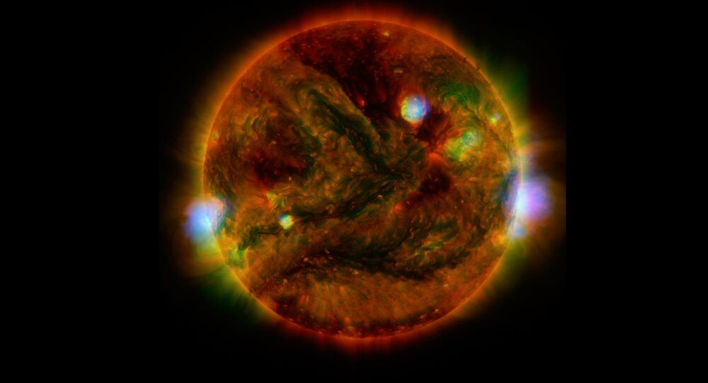 Flaring, active regions of our sun are highlighted in this new image combining observations from several telescopes