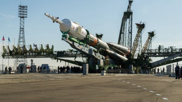 Installation of the rocket of space appointment (RSA) Soyuz-FG with the transport piloted ship Soyuz TMA-16M on a starting complex of the Baikonur spaceport - Sputnik International