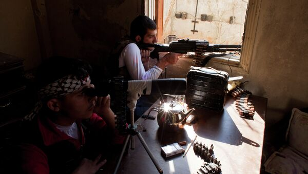 Syrian fighters with the Free Syria Army (FSA) man one of their positions during skirmishes with government forces in the Seif al-Dawla district in Aleppo on September 4, 2012 - Sputnik International