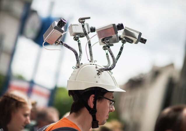 In this file photo dated May 30, 2015 Chairman of Hesse's Pirate Party Volker Berkhout wears a hat with mock surveillance cameras in Frankfurt am Main, central Germany