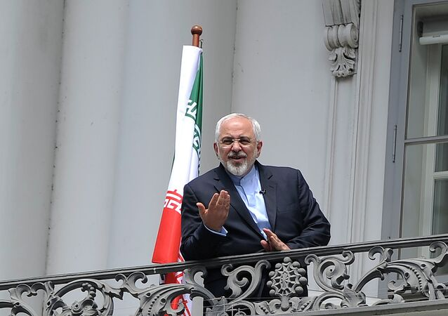 Iranian Foreign Minister Javad Zarif talks to media from bacon of the Palais Coburg Hotel, venue of the nuclear talks in Vienna, Austria on July 2, 2015