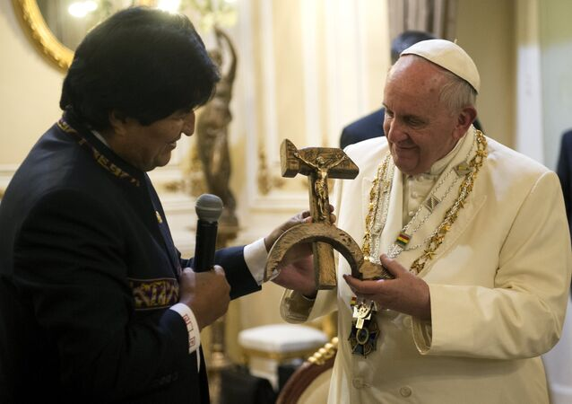 Pope Francis receives a gift from Bolivian President Evo Morales (L) in La Paz, Bolivia, July 8, 2015